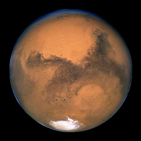 El Telescopio Espacial Hubble obtuvo esta imagen de Marte un día después de su oposición del 27 de agosto de 2003, durante la que se produjo la máxima aproximación entre el planeta rojo y la Tierra de los últimos 60.000 años. Créditos: STScI/NASA/ESA.
